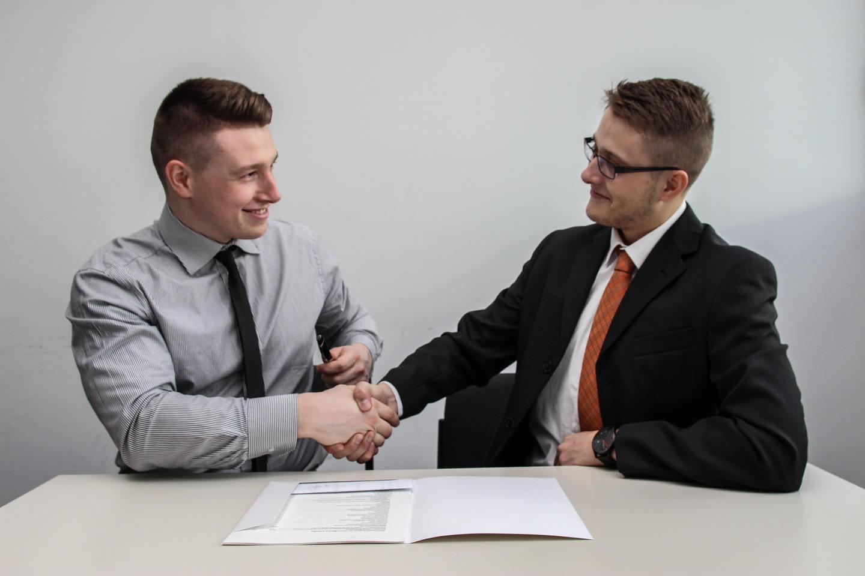 two men handshaking