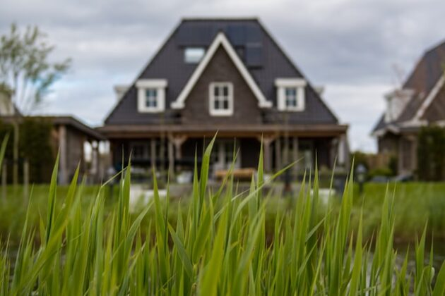 brown house with grass in front