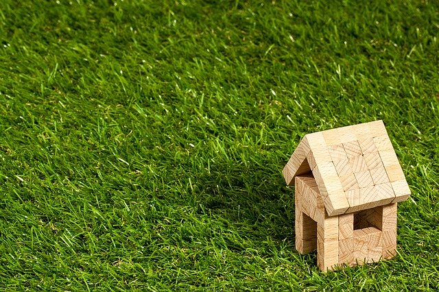 wooden house on grass