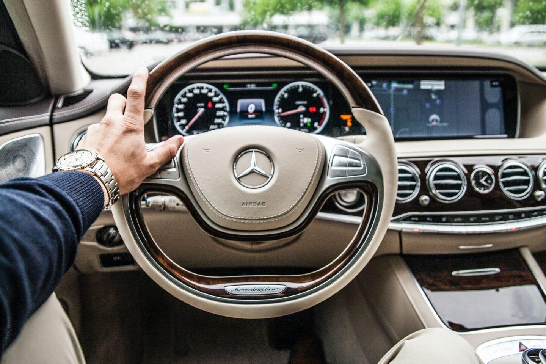 hand on steering wheel