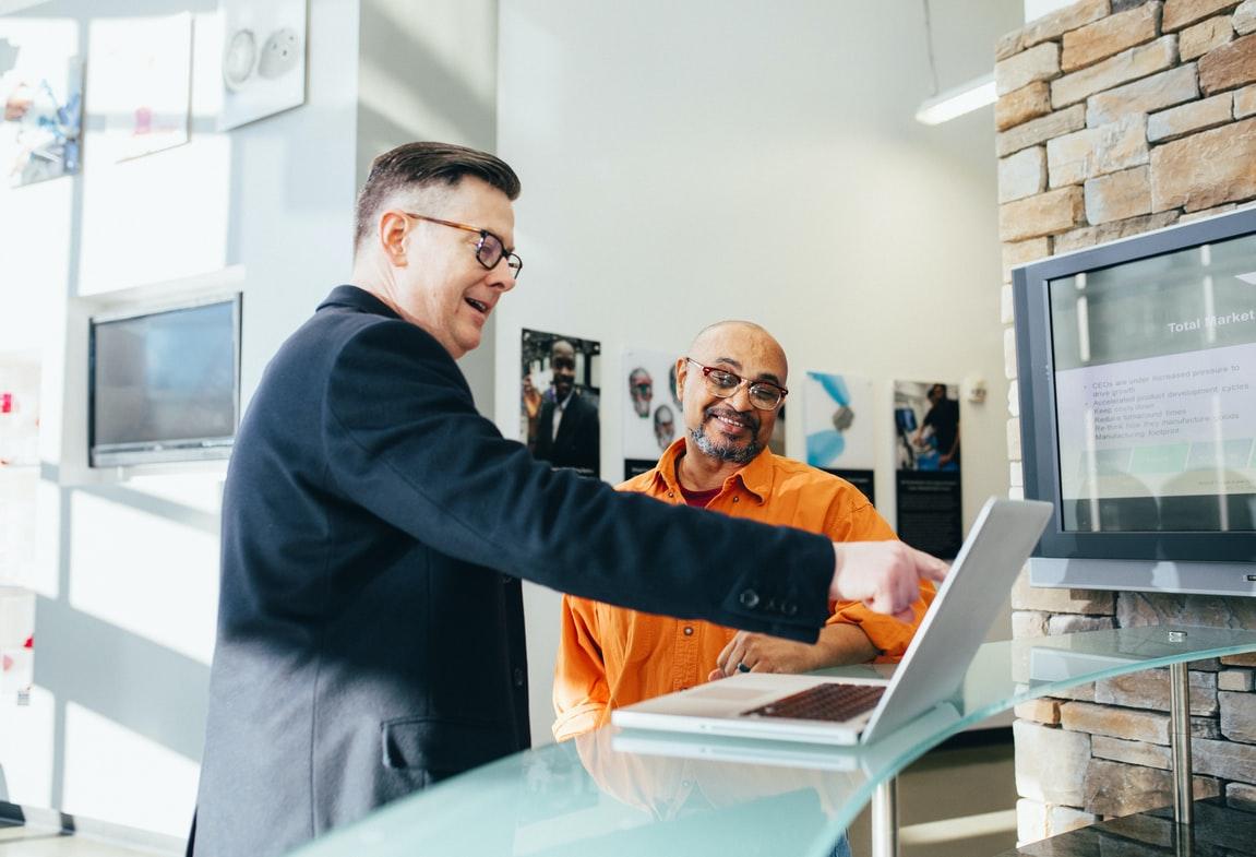 men looking at laptop